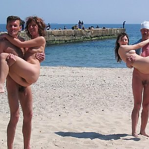 Barely legal young nudist lays naked at the beach
